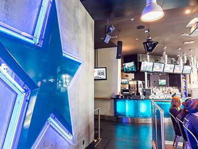 The bar area with an illuminated blue star on the wall