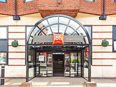 The arched entrance to the Ibis Hotel, Birmingham, in the day