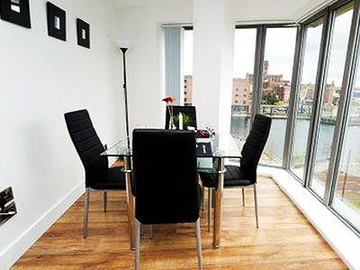 Table and chairs in a room with floor to ceiling windows