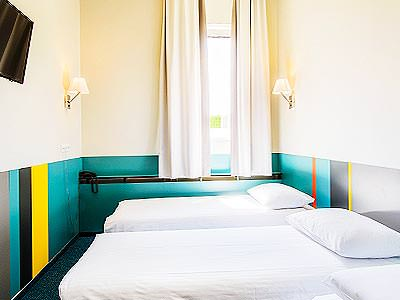 A colourful twin guest room at Ecotel Vilnius