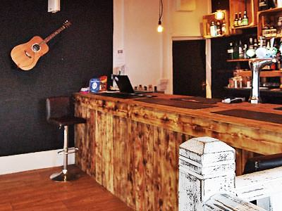 A bar with a guitar mouthed on the wall