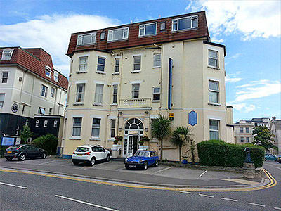 The exterior of the Bourne Hall Hotel, Bournemouth, during the day