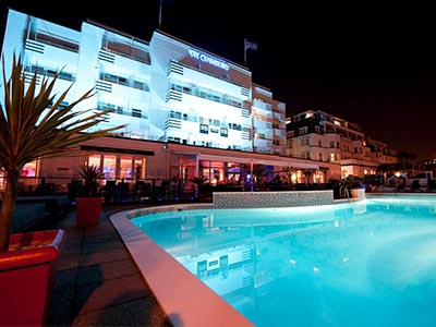The Cumberland Hotel's outdoor pool illuminated at night