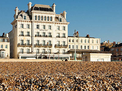 Exterior of the Mercure Brighton Seafront Hotel, and beach, during the day
