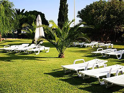 White sun loungers set out on grass