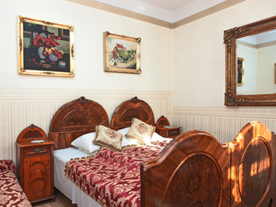 A double bed in a grand, old fashioned room