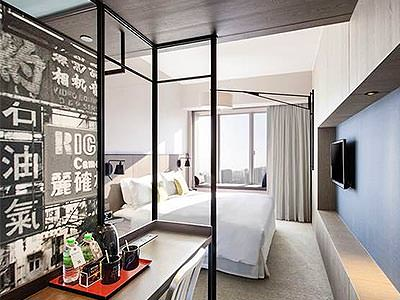 A bedroom with quirky decor inside, including Japanese writing