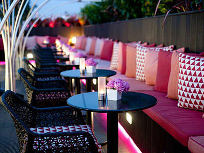 The Trafalgar Hotel rooftop bar, with a close up on tables and chairs