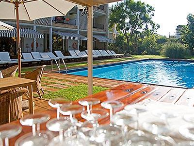 Sun loungers around an outdoor pool