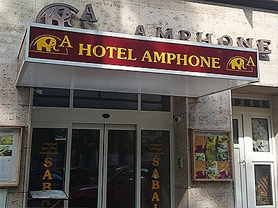 The red and yellow Hotel Amphone sign above the entrance