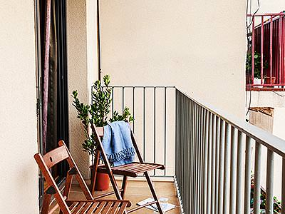 Two chairs on a balcony