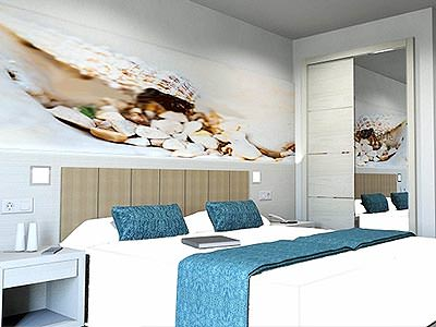 A guest bedroom at the Invisa Hotel Es Pla