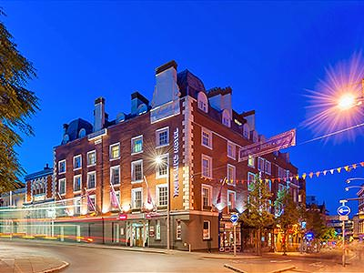 The exterior of Mercure Hotel in Nottingham, under a clear sky at dusk