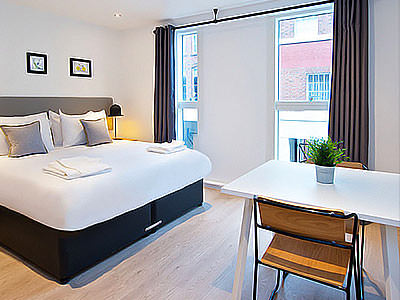A double room with white, modern interiors