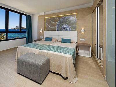 A guest bedroom at Marvella Club
