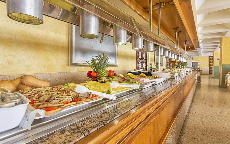 A line of food on counters in a restaurant