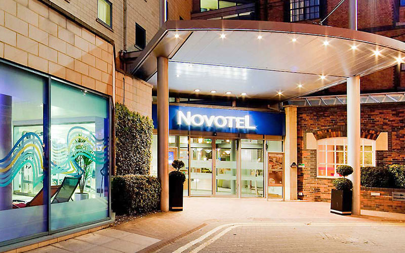 The lower-level exterior and entrance of the Novotel, Cardiff, at night