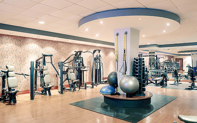 The gym area with weight machines and Pilates balls in Mercure Holland House & Spa Hotel Cardiff