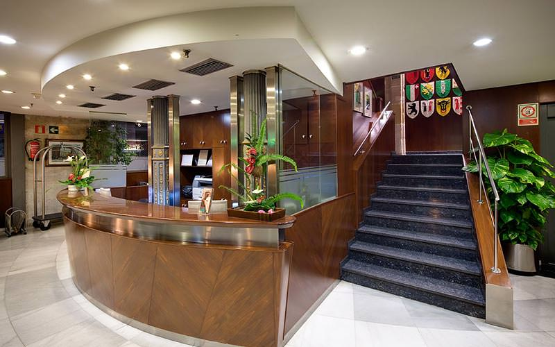 The reception desk at Hotel Suizo, with stairs along the side