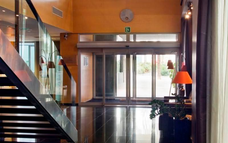 The lobby, with stairs in the corner, of Euro Hotel Diagonal Port