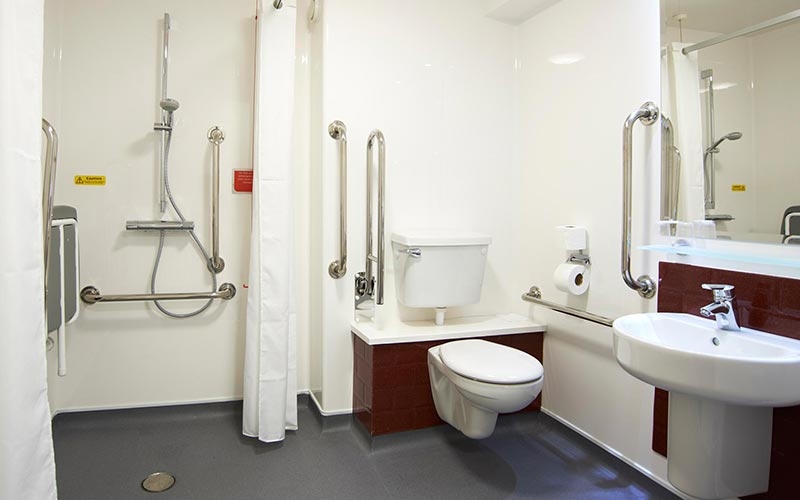 A white disabled bathroom in a Travelodge hotel room