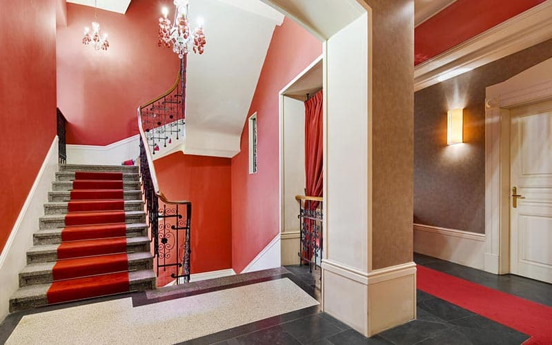A red hallway in a hotel