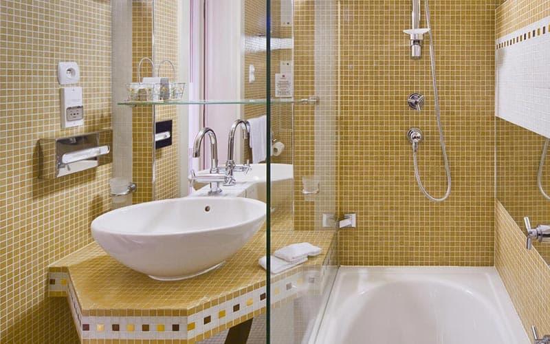 A tiled bathroom in a hotel