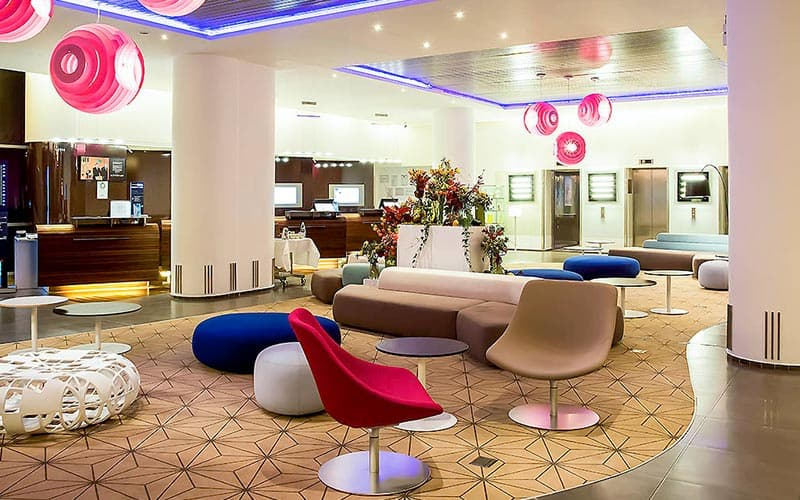The lobby of Novotel City Centre, Bucharest, with the reception desk in the background