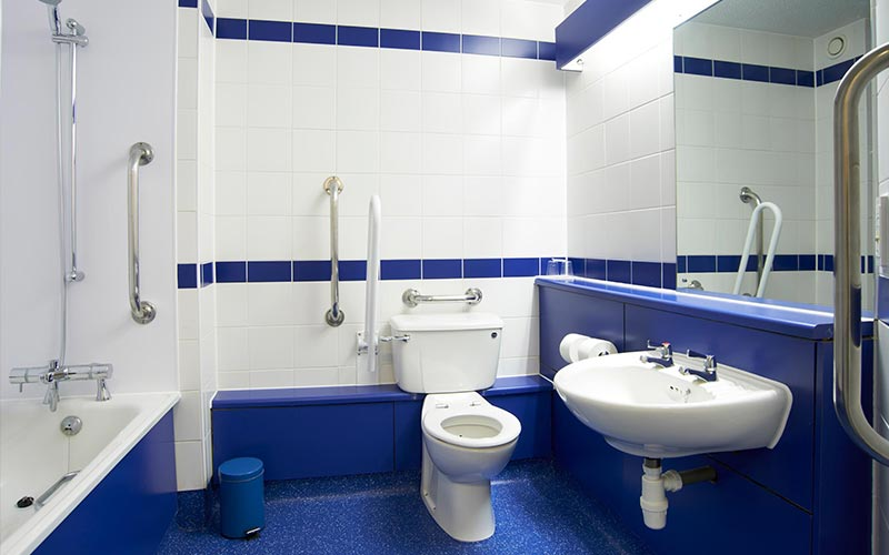 A blue and white tiled bathroom at a Travelodge