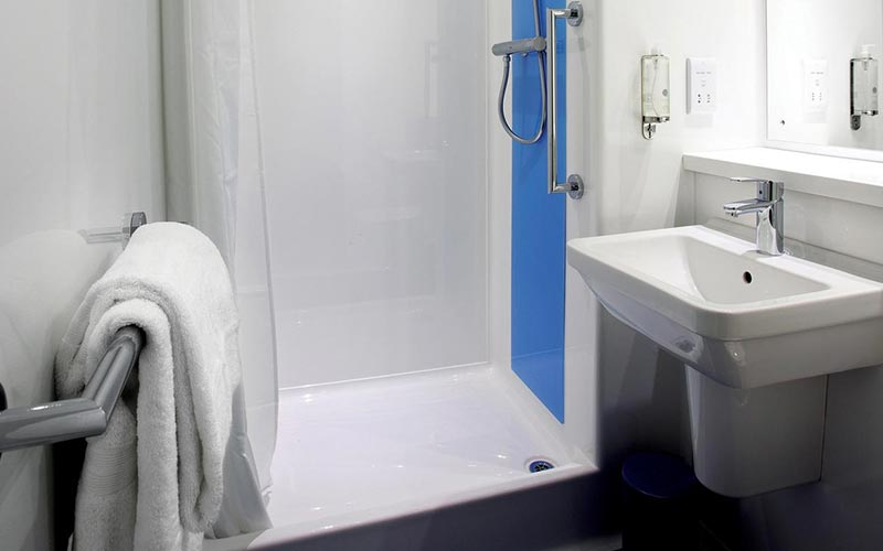 A white shower in a bathroom at a Travelodge