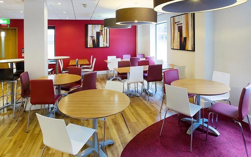 Tables and chairs in the bar at Travelodge Bristol