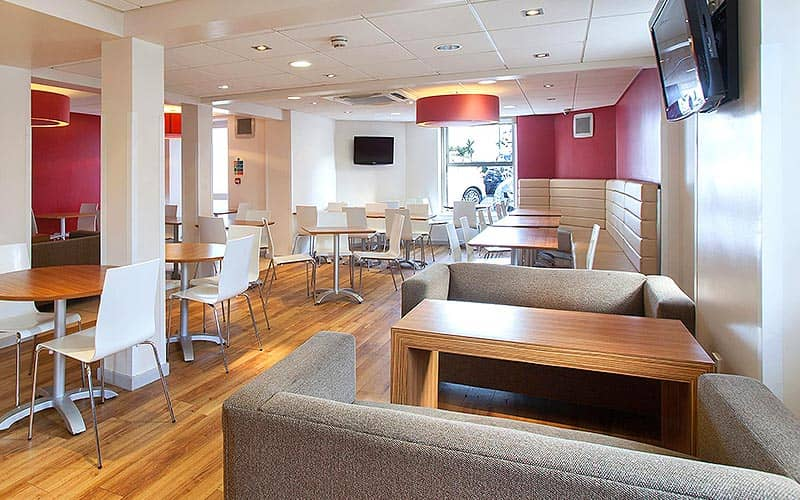 Various tables, chairs and sofas in the restaurant at Travelodge Bournemouth Seafront