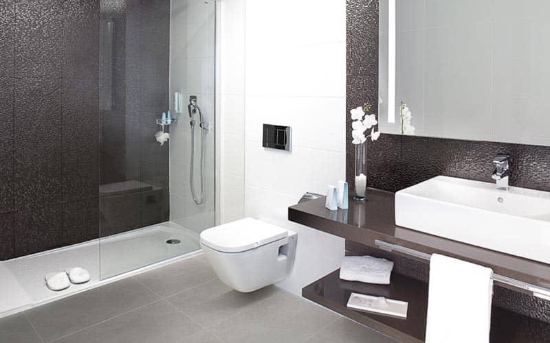A grey stylish bathroom in a hotel
