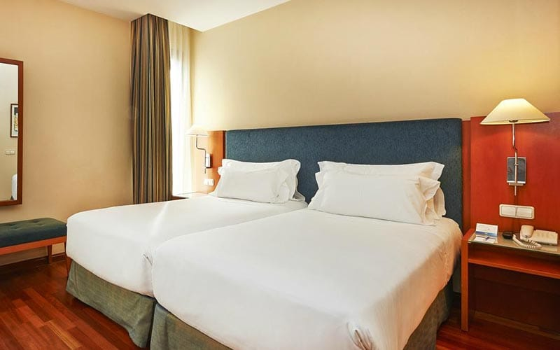 Two single beds in a hotel room at NH Barcelona Centro
