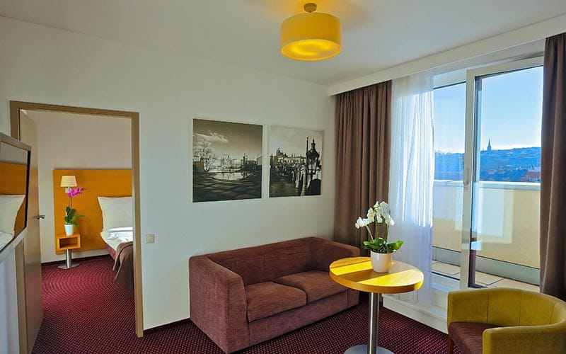 A suite in a hotel at Jurys Inn Prague, with a living and bedroom area