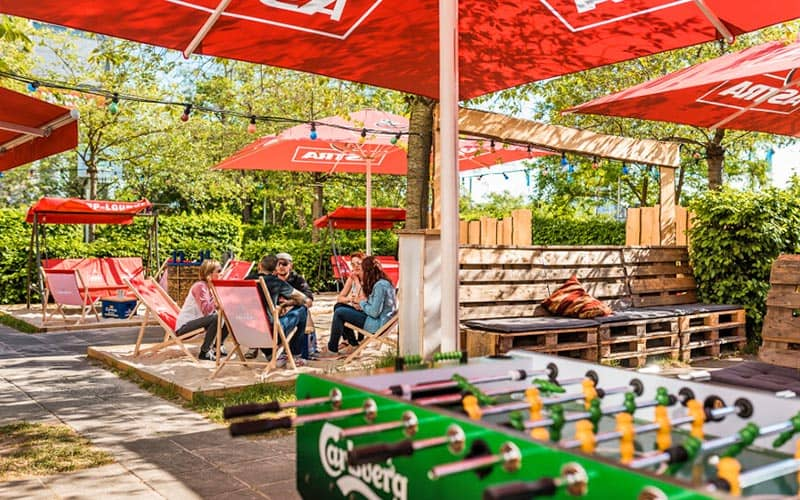 A beer garden with a table football table in the foreground