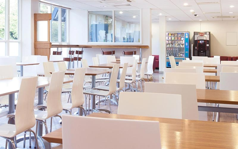 Tables and chairs in the bar and restaurant area at Travelodge Bournemouth