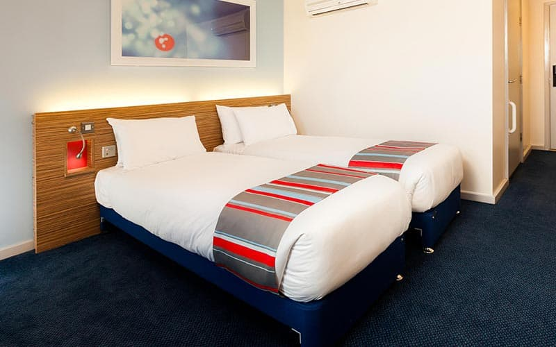 Two single beds in a room at Travelodge Edinburgh Central Princes Street hotel