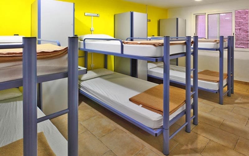 A yellow dorm room, with bunk beds, at Center Ramblas
