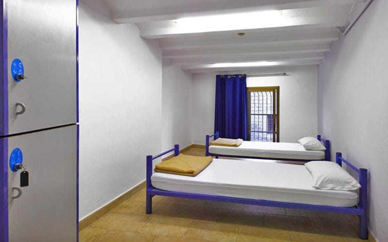 Two single beds in a dorm room at Center Ramblas