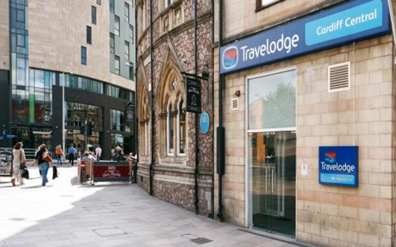 The exterior of Travelodge Cardiff Central, leading out onto a busy street
