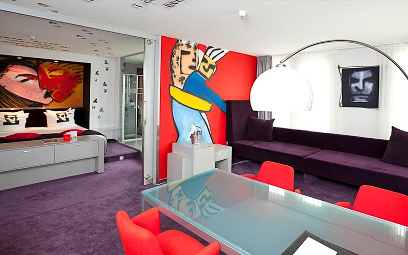 A modern suite at Westcord Art Hotel, with murals on the wall