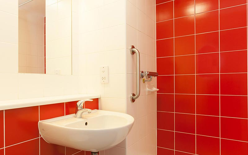 A red tiled bathroom at Travelodge Birmingham Central Newhall Street