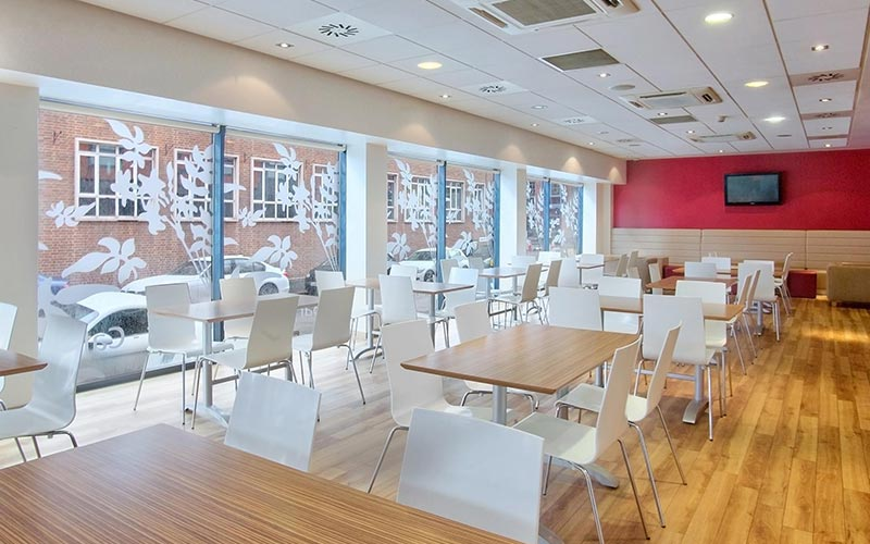Tables and chairs in the onsite bar and restaurant at Travelodge Birmingham Central Newhall Street
