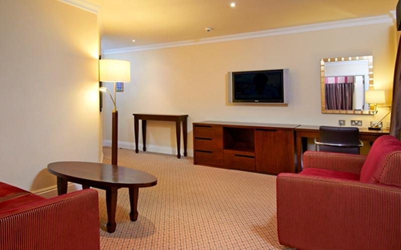 A living area in a suite at Hilton Avisford Park