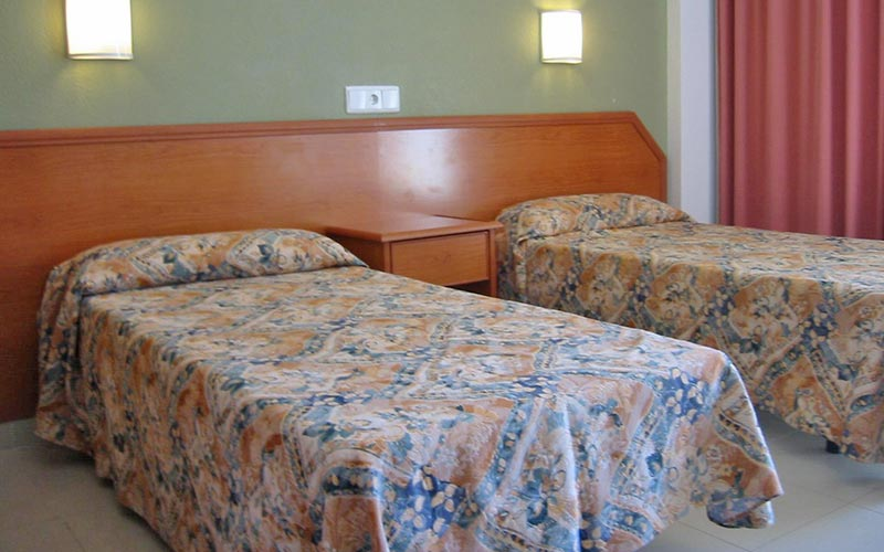 Two single beds in a hotel room at Hotel Joya