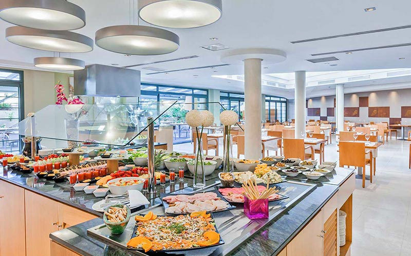 The breakfast restaurant, with a counter topped with food, at Occidental Estepona Hotel & Thalasso Spa