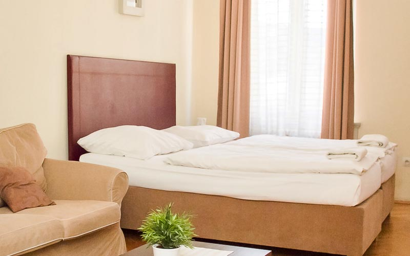 Two beds in a bedroom at the Riverview Apartments, Prague
