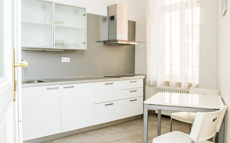 A kitchen, with a table for two, at the Riverview Apartments, Prague