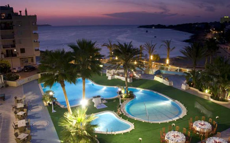 The view from one of the balconies of Blau Park Hotel, showing the pools illuminated at night